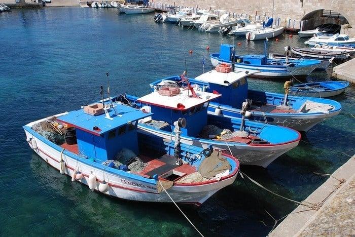 blue and white fishing boats at Gallipoli, Puglia, Italy